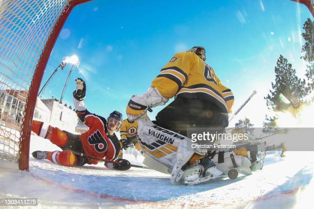 Joel Farabee of the Philadelphia Flyers scores a goal past Tuukka Rask of the Boston Bruins in the first period during the 'NHL Outdoors At Lake...