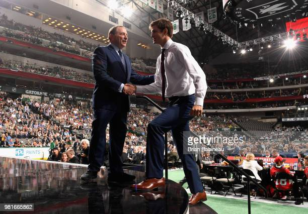 Joel Farabee shakes the hand of NHL Commissioner Gary Bettman after being selected fourteenth overall by the Philadelphia Flyers during the first...