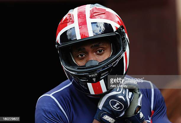 Joel Fearon a brakeman for the Great Britain bobsleigh squad prepares for a training run down the bobsleigh push track at Bath University on August 9...