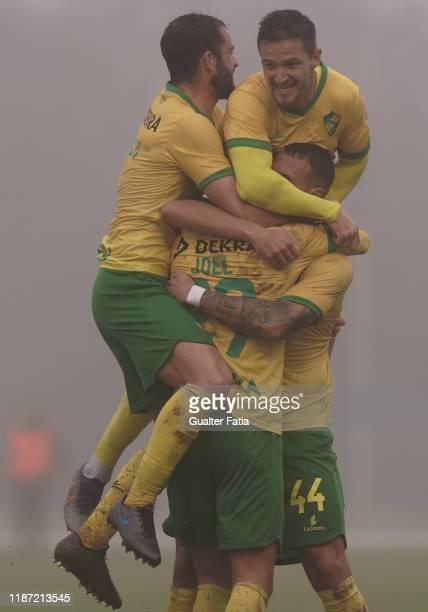 Joel Ferreira of CD Mafra celebrates with teammates after scoring a goal during the Liga Pro match between CD Mafra and GD Estoril Praia at Estadio...