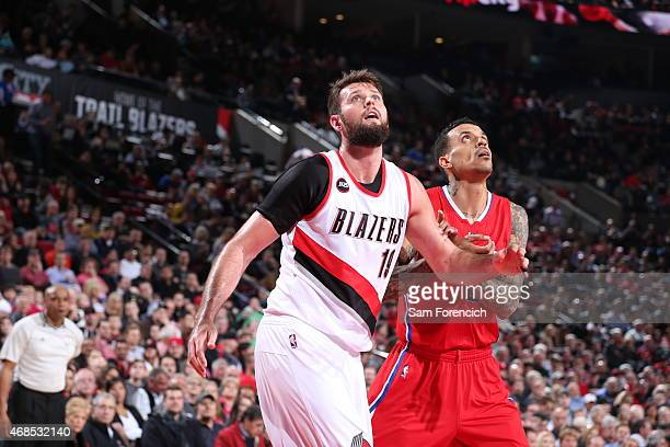Joel Freeland of the Portland Trail Blazers battles for position against Matt Barnes of the Los Angeles Clippers on April 1 2015 at the Moda Center...