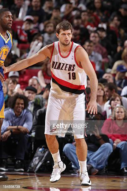 Joel Freeland of the Portland Trail Blazers defends against the Golden State Warriors on October 19 2012 at the Rose Garden Arena in Portland Oregon...
