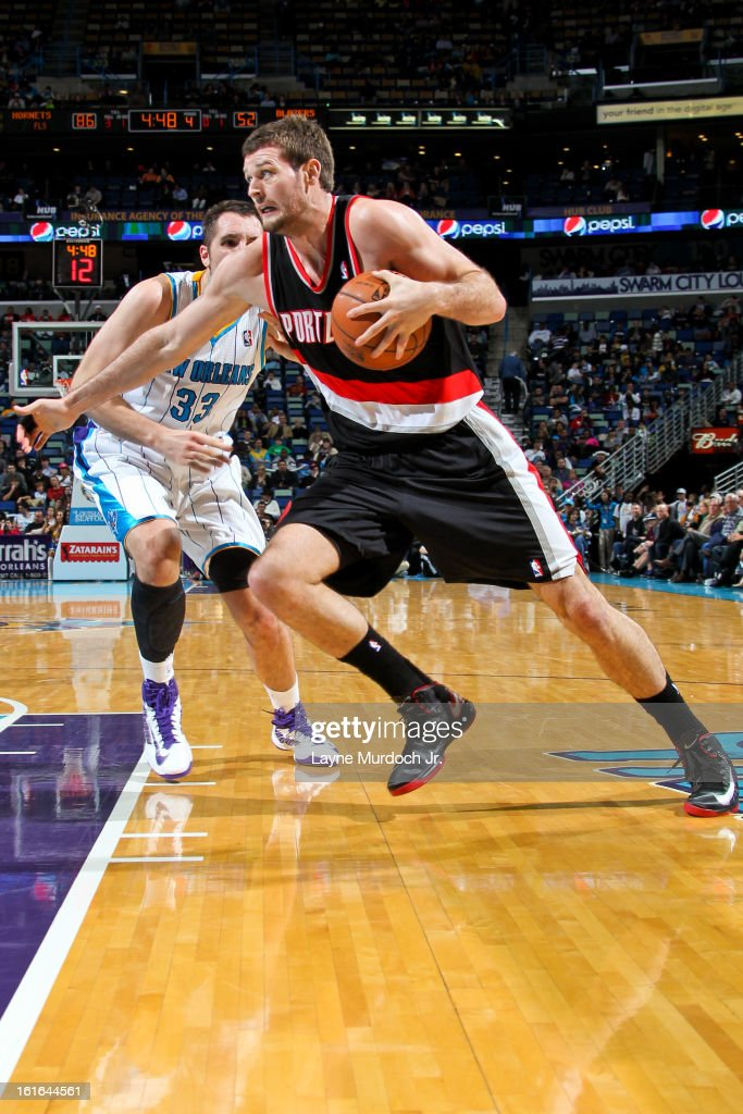 Joel Freeland #19 of the Portland Trail Blazers drives to the basket against Ryan Anderson #33 of the New Orleans Hornets on February 13, 2013 at the New Orleans Arena in New Orleans, Louisiana.