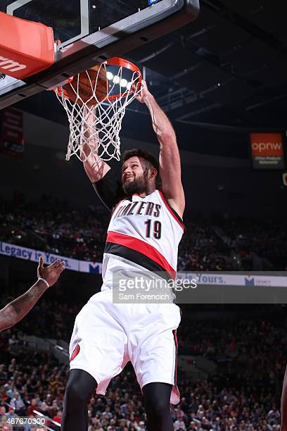 Joel Freeland of the Portland Trail Blazers dunks against the Golden State Warriors on March 24 2015 at the Moda Center Arena in Portland Oregon NOTE...