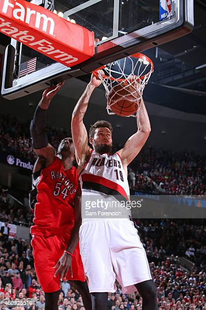 Joel Freeland of the Portland Trail Blazers dunks against the Toronto Raptors during the game on December 30 2014 at the Moda Center in Portland...