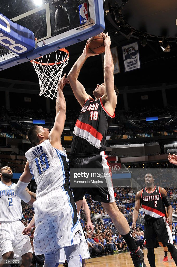 Joel Freeland #19 of the Portland Trail Blazers goes to the basket against Gustavo Ayon #19 of the Orlando Magic on February 10, 2013 at Amway Center in Orlando, Florida.