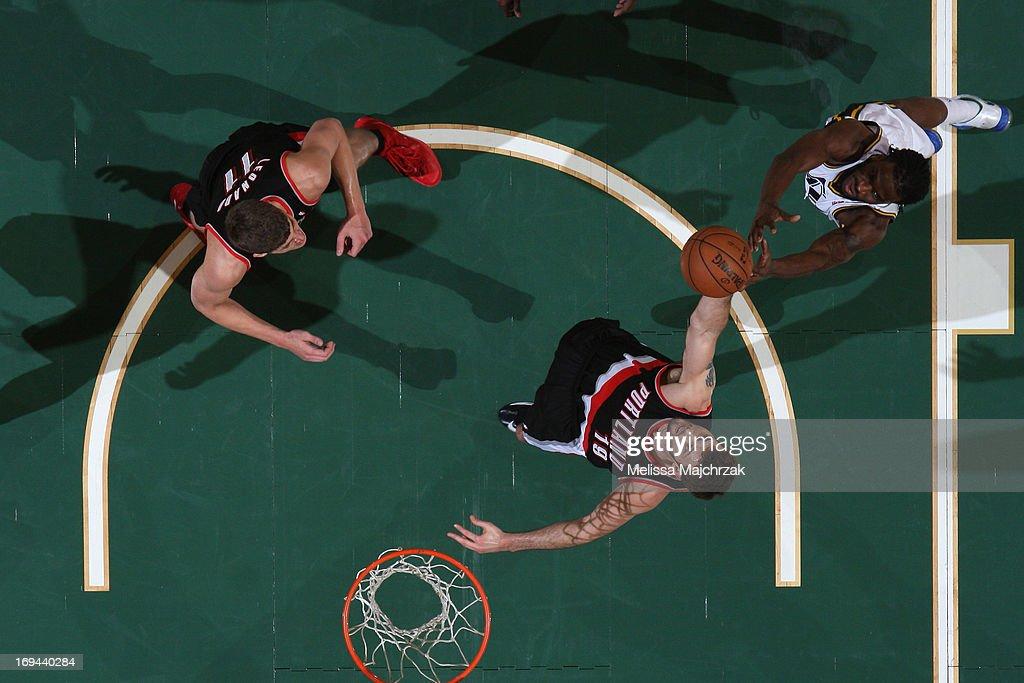 Joel Freeland #19 of the Portland Trail Blazers grabs a rebound against DeMarre Carroll #3 of the Utah Jazz at Energy Solutions Arena on April 1, 2013 in Salt Lake City, Utah.