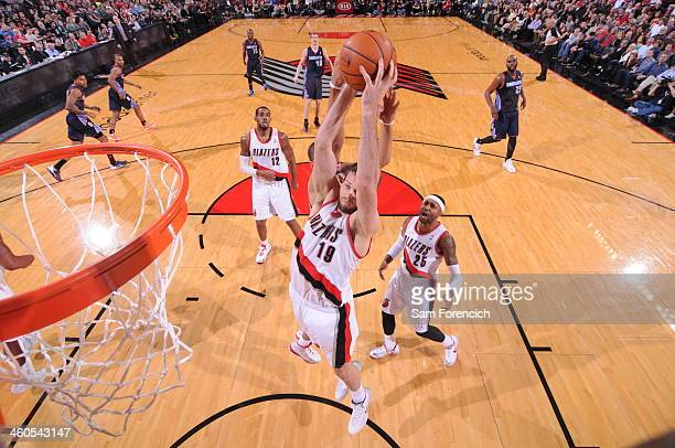 Joel Freeland of the Portland Trail Blazers grabs a rebound against the Charlotte Bobcats on January 2 2014 at the Moda Center Arena in Portland...