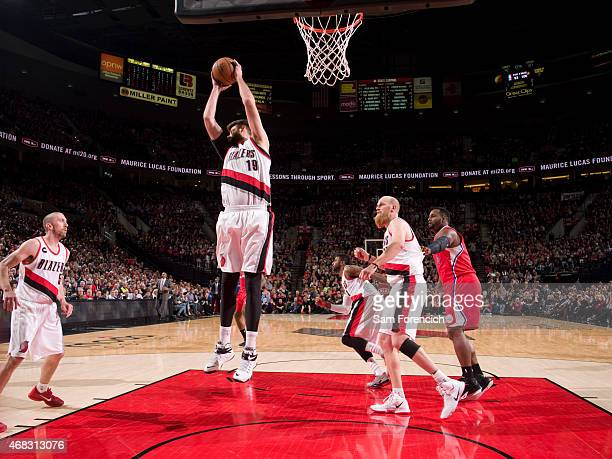 Joel Freeland of the Portland Trail Blazers grabs a rebound against the Los Angeles Clippers on April 1 2015 at the Moda Center in Portland Oregon...