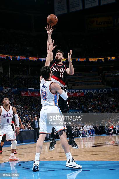 Joel Freeland of the Portland Trail Blazers shoots against the Oklahoma City Thunder on April 13 2015 at Chesapeake Energy Arena in Oklahoma City...