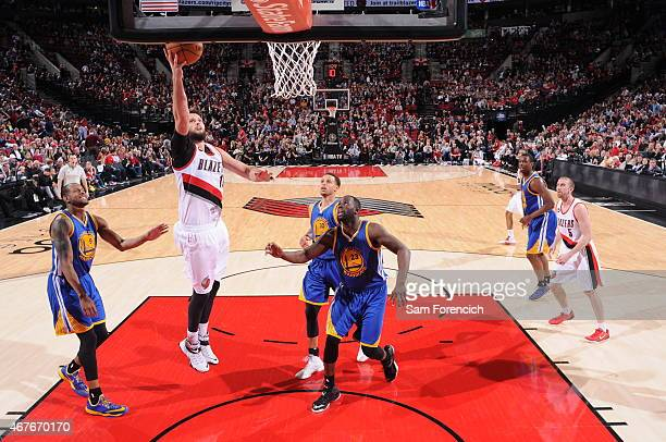 Joel Freeland of the Portland Trail Blazers shoots against the Golden State Warriors on March 24 2015 at the Moda Center Arena in Portland Oregon...