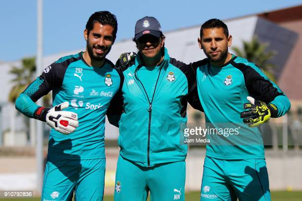 Joel Garcia Nicolas Navarro goalkeeping coach and Jonathan Orozco of Santos pose for a photo during the training of team Santos previous the fourth...