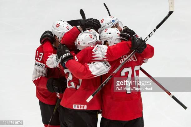Joel Genazzi of Switzerland celebrates his goal with teammates during the 2019 IIHF Ice Hockey World Championship Slovakia group game between Sweden...