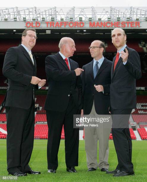 Joel Glazer , Avram Glazer and Bryan Glazer , sons of new Manchester United owner Malcolm Glazer and new members of the board of directors talk with...