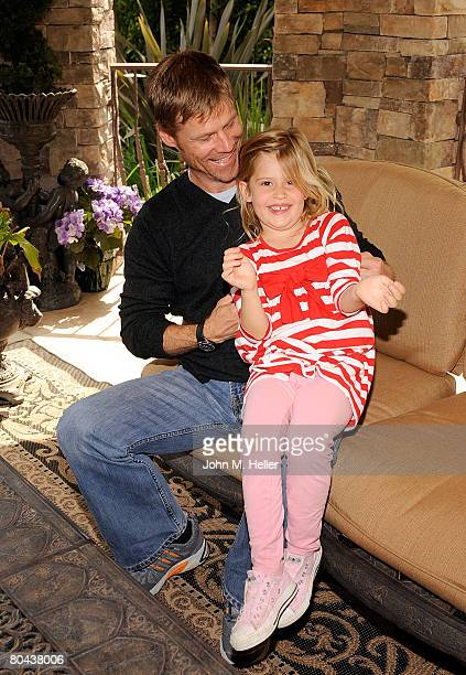 Joel Gretsch having some fun with his daughter Kaya Gretsch at the art opening of Giorgio Tuscani and Elizabeth Shatner on March 29 2008 at a private...