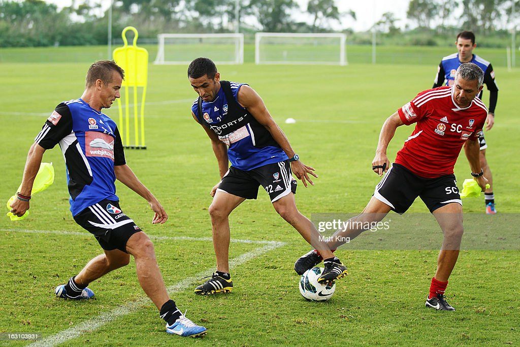 Joel Griffiths (L) and Ali Abbas (C) complete a drill with assistant coach Steve Corica (R) during a Sydney FC A-League training session at Macquarie Uni on March 5, 2013 in Sydney, Australia.