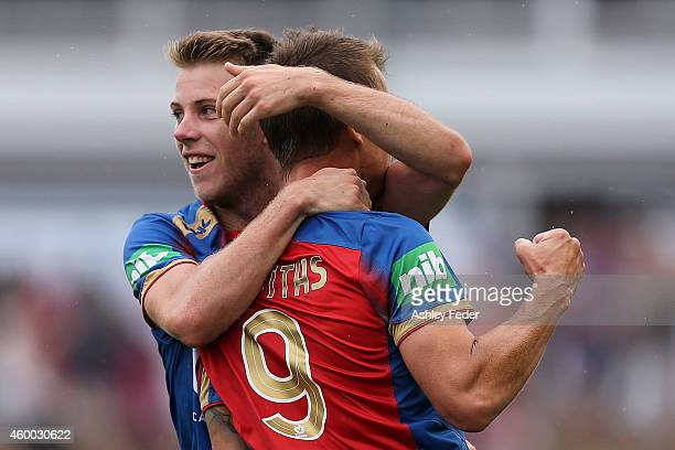Joel Griffiths and Andrew Hoole of the Jets celebrate a goal during the round 10 ALeague match between the Newcastle Jets and the Wellington Phoenix...