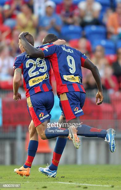 Joel Griffiths and Emile Heskey of the Jets celebrate a goal during the round 24 ALeague match between the Newcastle Jets and Wellington Phoenix at...