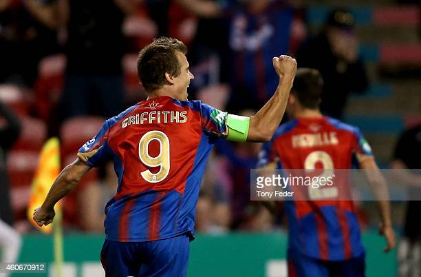 Joel Griffiths of the Jets celebrates a goal with team mate Scott Neville during the round 12 A-League match between the Newcastle Jets and t...