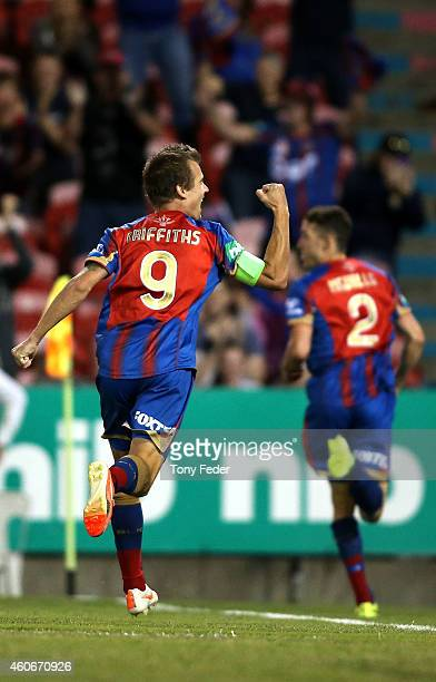 Joel Griffiths of the Jets celebrates a goal with team mate Scott Neville during the round 12 A-League match between the Newcastle Jets and Adelaide...