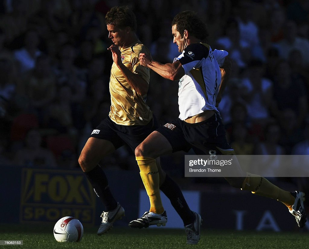 Joel Griffiths of the Jets competes with Dean Heffernan of the Mariners during the round 14 A-League match between the Newcastle Jets and the Central Coast Mariners at EnergyAustralia Stadium on November 25, 2007 in Newcastle, Australia.