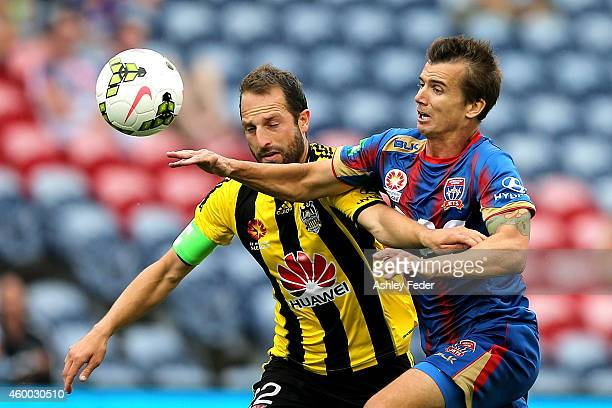 Joel Griffiths of the Jets contests the ball against Andrew Durante of the Phoenix during the round 10 ALeague match between the Newcastle Jets and...