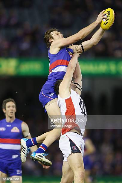Joel Hamling of the Bulldogs marks the ball over Jesse Hogan of the Demons during the round 20 AFL match between the Western Bulldogs and Melbourne...