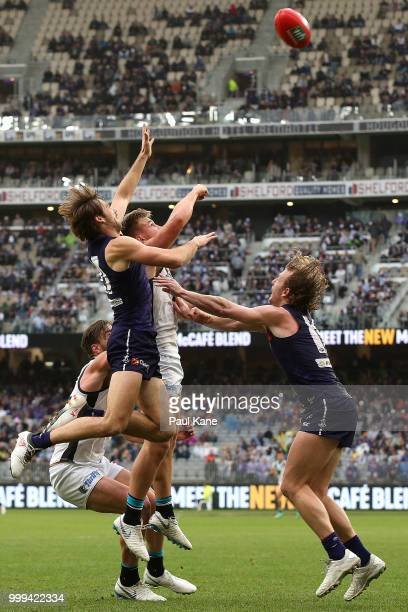 Joel Hamling of the Dockers and Ollie Wines of the Power contest for a mark during the round 17 AFL match between the Fremantle Dockers and the Port...