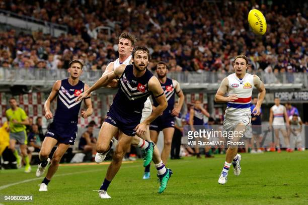 Joel Hamling of the Dockers chases the ball during the round five AFL match between the Fremantle Dockers and the Western Bulldogs at Optus Stadium...