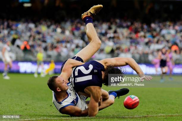 Joel Hamling of the Dockers is tackled by Billy Hartung of the Kangaroos during the round 10 AFL match between the Fremantle Dockers and the North...