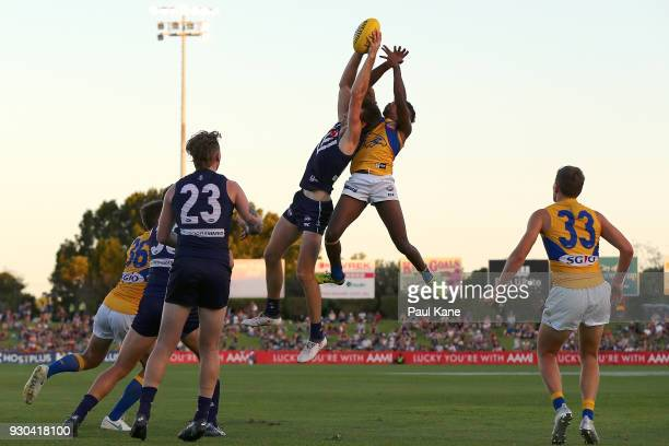 Joel Hamling of the Dockers marks the ball against Liam Ryan of the Eagles during the JLT Community Series AFL match between the Fremantle Dockers...