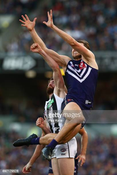 Joel Hamling of the Dockers sets for a mark against Tyson Goldsack of the Magpies during the round 11 AFL match between the Fremantle Dockers and the...
