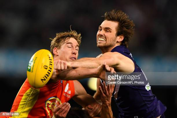 Joel Hamling of the Dockers spoils a mark attempt from Tom Lynch of the Suns during the 2017 AFL round 20 match between the Fremantle Dockers and the...