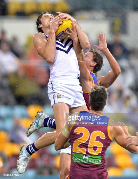 Joel Hamling of the Dockers takes a mark during the round 12 AFL match between the Brisbane Lions and the Fremantle Dockers at The Gabba on June 10...