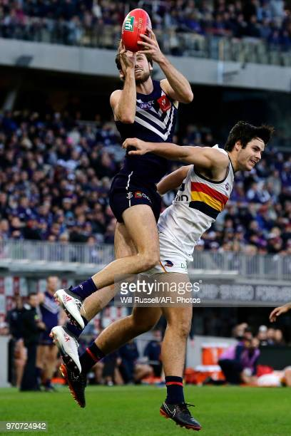 Joel Hamling of the Dockers takes an overhead mark during the round 12 AFL match between the Fremantle Dockers and the Adelaide Crows at Optus...