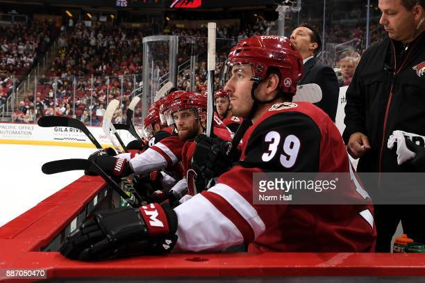 Joel Hanley of the Arizona Coyotes looks on from the bench against the New Jersey Devils at Gila River Arena on December 2 2017 in Glendale Arizona
