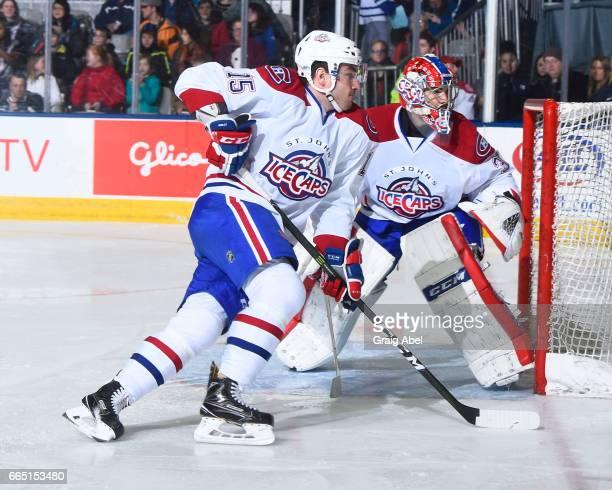 Joel Hanley skates in front of team mate goalie Yann Danis of the St John's IceCaps against the Toronto Marlies during AHL game action on April 4...