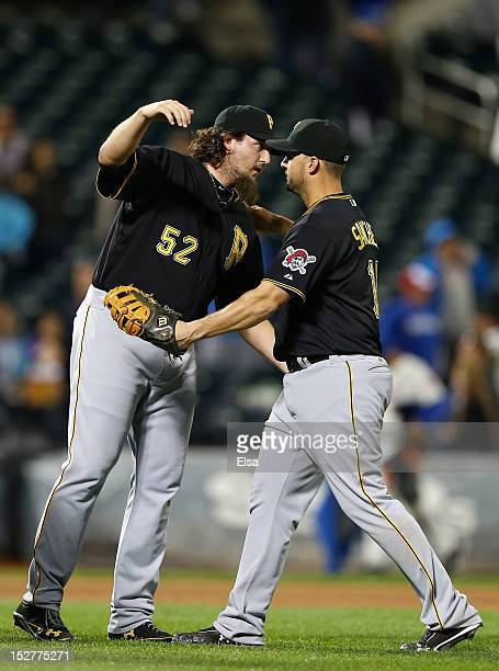 Joel Hanrahan of the Pittsburgh Pirates celebrates the win over the New York Mets with teammate Gaby Sanchez after the game on September 25 2012 at...