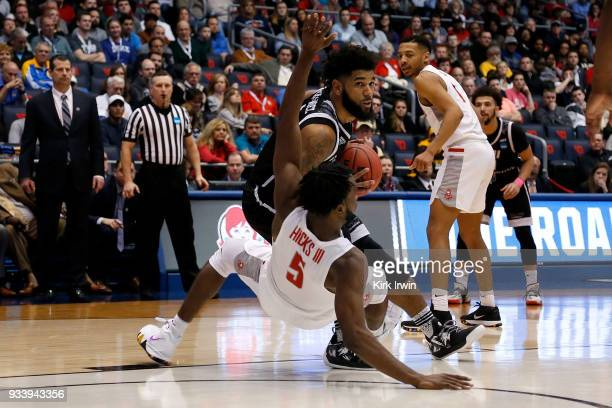 Joel Hernandez of the LIU Brooklyn Blackbirds runs into Donald Hicks of the Radford Highlanders during the game at UD Arena on March 13 2018 in...
