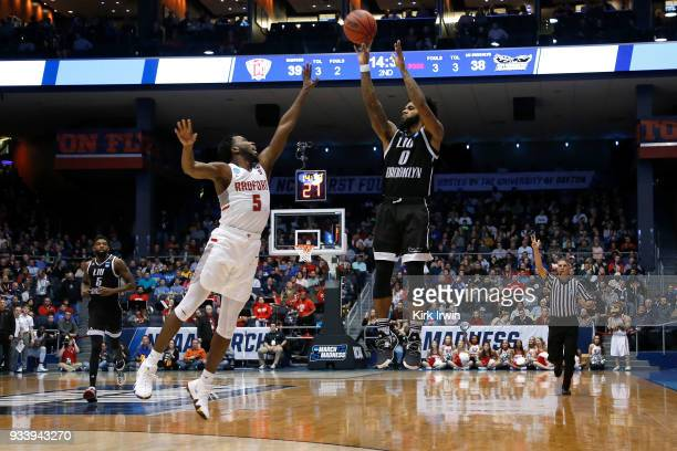 Joel Hernandez of the LIU Brooklyn Blackbirds shoots a three point shot over Donald Hicks of the Radford Highlanders during the game at UD Arena on...