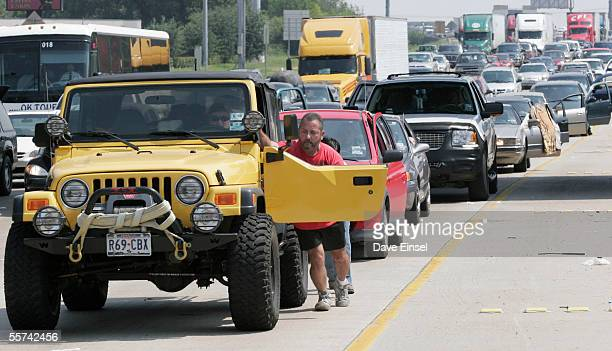Joel Hernandez pushes his high performance Jeep on Interstate 10 September 22 2005 near downtown Houston Texas The Jeep gets about 85 miles/gallon...