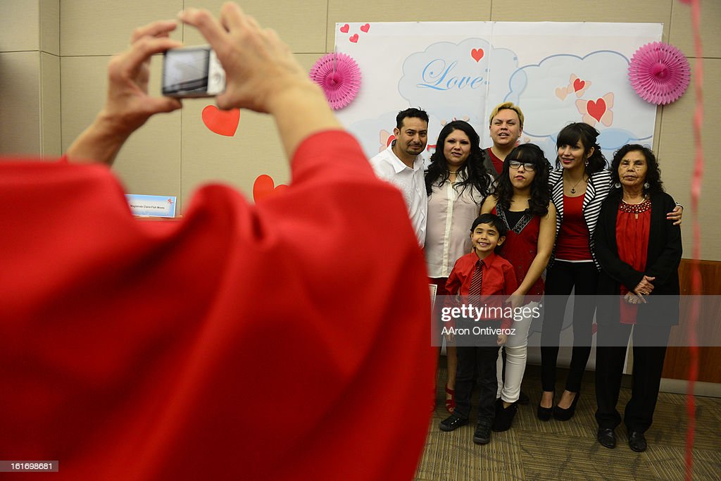 Joel Herrera and Sylvenvestra Rodriguez pose with their family during a Valentine's Day marriage celebration at the Denver Clerk and Recorder's office. Couples applying for marriage licenses received gift bags containing gift certificates to local restaurants among other treats to celebrate their union.