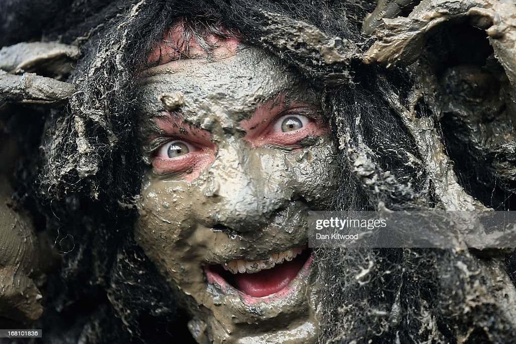 Joel Hicks, who was raising money for the 'Always With a Smile' charity, takes part in the Maldon Mud Race in Maldon, Essex on May 05, 2013. The race originated in 1973 and involves competitors racing around a course on the mudbanks of the river Blackwater at low tide.