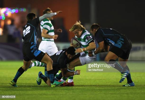 Joel Hodgson of Newcastle Falcons is tackled by Mikheil Gachechiladze of EniseiSTM during the European Rugby Challenge Cup match between Newcastle...