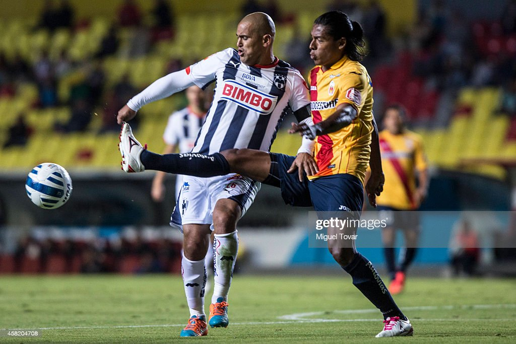 Joel Huiqui of Morelia (R) fights for the ball with Humberto Suazo of Monterrey (L) during a match between Morelia and Monterrey as part of 15th round Apertura 2014 Liga MX at Jose Maria Morelos y Pavon Stadium on October 31, 2014 in Morelia, Mexico.