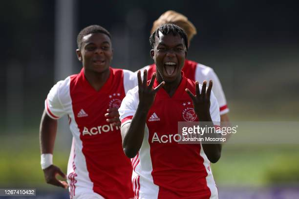 Joel Ideho of Ajax celebrates with team mates Sontje Hansen and Christian Rasmussen after scoring to give the side a 3-0 lead during the UEFA Youth...