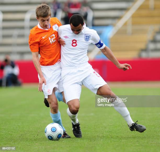 Joel Ivo Veltman of Netherlands and John Bostock of England battle for the ball during the UEFA U17 European Championship between England and...