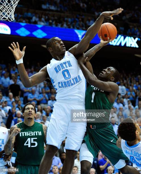Joel James of the North Carolina Tar Heels fouls Durand Scott of the Miami Hurricanes during play at Dean Smith Center on January 10, 2013 in Chapel...