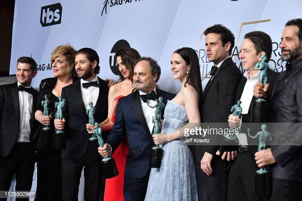 Joel Johnstone Caroline Aaro Michael Zegen Marin Hinkle Kevin Pollak Rachel Brosnahan Luke Kirby Brian Tarantina and Tony Shalhoub pose in the press...
