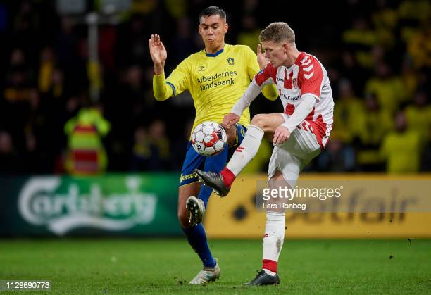 Joel Kabongo of Brondby IF and Kasper Kusk of AaB Aalborg compete for the ball during the Danish Superliga match between Brondby IF and AaB Aalborg...